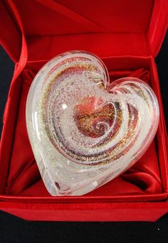 Glass art infused with cremation ash as a gift for the grieving - these pieces give them a way to hold onto a person or pet that they have lost. Made by Celebration Ashes.