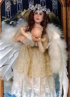 Beautiful Christmas angel holding baby