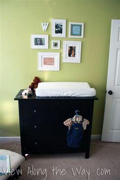 Mini gallery wall in a green baby boy nursery.