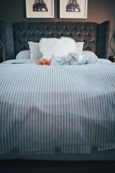 newborn baby girl on big bed at home lifestyle photography essex documentary photography