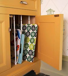 Curtain tension rods help keep your baking sheets and large trays organized. Place a few rows inside your cabinets and you have an instant and inexpensive solution for keeping these items upright and easy-to-reach.