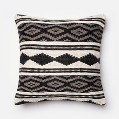 Tribal style. Accessorize your sofa with cool geometric patterns and shapes, perfect for a space decorated with a southwestern landscape in mind.