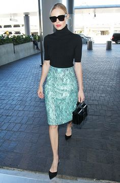 Kate Bosworth wears green Christopher Kane pencil skirt with a black turtleneck and slingback flats.