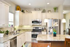 COASTAL STYLE KITCHEN, GRANITE COUNTERTOPS, WHITE CABINETS. NEAL  COMMUNITIES, FRESHWATER 2,