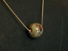 Minimalist Ceramic Bead Necklace by thedepo on Etsy,