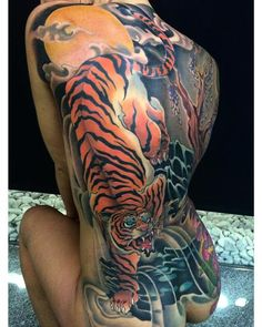 Finished the backpiece of Sandra!! Thanks very much Sandra you sit like a tiger,4 sessions and the all back done!!!tuff girl… #fusionink #revolutionneedles #killerink #hustlebutterdeluxe #thebesttattooartists #tattooartist #inkjunkeyz #neotrad...