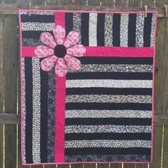 Black and white with pink baby quilt.  This would also be cute for the back of a quilt.
