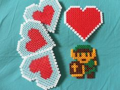 Zelda Nintendo heart container perler bead coasters PLUS Link magnet Melty Bead Patterns, Perler Patterns, Beading Patterns, Perler Bead Art, Perler Beads, Pixel Beads, Fusion Beads, Bead Crafts, Geek Stuff
