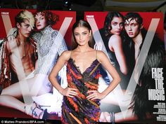 Gorgeous: Taylor Hill, 20, stunned in a frayed multi-coloured gown ...