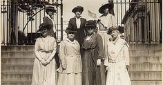This delegation of officers of the National American Woman Suffrage Association received from President Wilson a memorial to the French women in which he advocates the federal woman suffrage amendment. The picture was made on steps leading to executive offices of the White House. Front row, left to right: Mrs. Wood Park, Dr. Anna Howard Shaw, Mrs. Carrie Chapman Catt, Mrs. Helen H. Gardner: second row, Miss Rose Young, Mrs. George Bass, and Miss Ruth White. 1917 - 1918