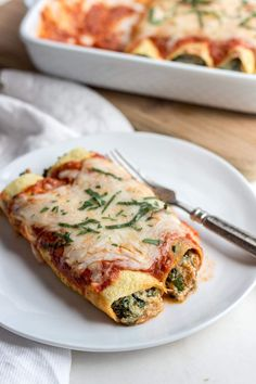 "Low carb spinach manicotti stuffed with spinach and ricotta cheese & use low carb crepes as the ""noodle"" making them a great low carb pasta option! This comfort food dinner recipe is also vegetarian."