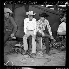 BACK OF THE CHUTES.  Stock contractor Hank Christensen with saddle bronc champion Casey Tibbs - Reno Rodeo - Reno, Nevada - 1963 - Photo by DeVere.