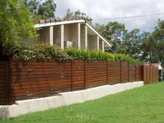 Hardwood fence and hedge