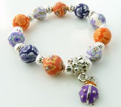 Snazzy Girls 10mm Polymer Clay Lady Bug Charm Bracelet - Orange & Purple | Snazzy Beads: Handmade Clay Jewelry, Polymer Clay Bracelets, Polymer Clay Earrings and Polymer Clay Necklaces