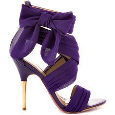 You'll go head over heels for this alluring and whimsical Paris Hilton style. Selene showcases a purple chiffon fabric upper criss crossing at the straps and showcasing a beautiful bow placed at the side. A zipper in the back makes for a quick fit while a 4 inch stiletto heel gives you the perfect boost.