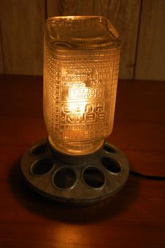 Chicken Feeder and antique peanut butter jar lamp $75