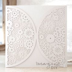 Rita Laser Cut Range in White Laser cut wedding invitations perfect for your luxury wedding. DIY laser cuts are easy and elegant with options to insert your own printer inserts.