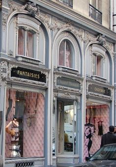 "Parisian store front - theme based on store's name .. ""fantasies"" ... in back window, you can see silhouette of female in black card stock .."