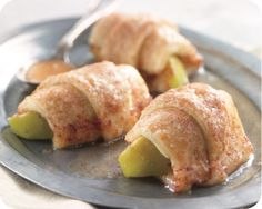 Apple Dumpling Dessert  2      Pillsbury Crescent Rolls  4 Granny Smith apples, cored & quartered  1 stick butter, melted  1 1/2 cup sugar  2 tap cinnamon  1 can (12oz) Mountain Dew® , soft drink   Roll up apples  - place in pan - melt butter with cinnamon & sugar - pour on top - top with Mountain Dew - Bake 350  for 20-25 minutes.
