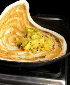 Mysore Masala Dosa recipe is a classic among South Indian breakfast recipes. Red chutney or podi is spread on the dosa, served with potato masala & chutney.