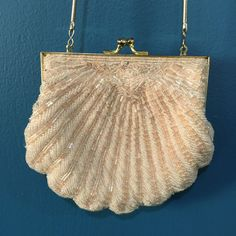 A personal favorite from my Etsy shop https://www.etsy.com/listing/255885586/beaded-shell-pursehandbagevening-bag