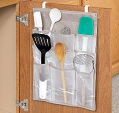 (Use cheap shoe bags and cup hooks.)Cabinet Door Organizer @ Harriet Carter...this is a good idea if you don't have drawers in your rv