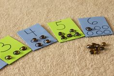 counting cards - I would do this with cheerios - then it would be safe to eat, no choking hazard : ) - could do with assorted beads when older
