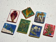 Floral magnets with handmade paper by Boby Dimitrov, via Flickr