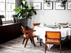Get the Look: Cool Gray Dining Room: A little bit of leather warms up this otherwise cool dining room, designed by Studio Ilse. via @domainehome