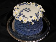 I decided to make this basket weave cake modeled off of one that appeared in a Wilton Cake Decorating Book. The daisy flowers are royal icin...