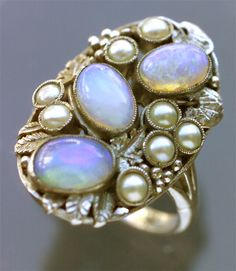 EDITH M. LINNELL  Arts & Crafts Ring   Silver Opal Pearl  H: 2.5 cm (0.98 in)  W: 1.6 cm (0.63 in)   British, c.1925  Original Fitted Case  Original case the silk marked:   Edith Linnell, Handwrought Jewellery, 184 Sloane St. SW1    Ref: 4795