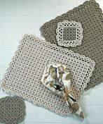 Coaster and placemat set that can be made in a variety of color combinations.