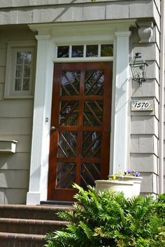stained custom-made front door (Chippendale lines w/ glass) - Lucy Williams interior design blog