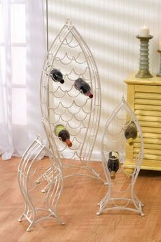 "White Nested Fish Wine Rack - Set of 3 by Peachy Kitchen. $179.99. S: 21""H x 10""W x 6.5""H. Iron. L: 45""H x 20""W x 8""H. White. A school of fish of a different nature! Why keep your wine in a cabinet, when you can store it in a wine rack that is as decorative as it is functional? Up to twenty bottles can be stored in the largest of these three fish, and the smaller ones follow behind with a capacity of six and nine. Thanks to their sturdy handles, these solid wine racks can eas..."