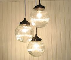 What about this? It is a chandelier of 3 lights and it is time period sensitive without adding any new flavor that may be too much plus it ties in both rooms. Huh?