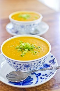 Curried carrot soup. Ingredients: olive oil, green onions, carrots, red lentils, curry powder, ginger, chilli powder, vegetable broth, coconut milk. Vegan recipe from Naturally Ella.