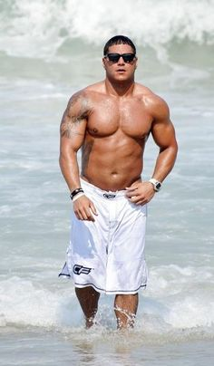 """Jersey Shore"" cast member Ronnie Ortiz-Magro shows off his abs while enjoying the sun and surf in Seaside Heights, NJ."