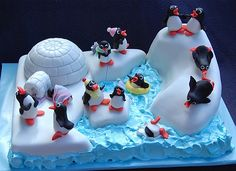 Penguin cake -The cake is an organic chocolate cake, the large iceburgs are gluten free- a rice bubble marshmallow concoction.