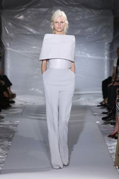 Maison Martin Margiela - Leather heart shaped top worn with fluid trousers, stilettos and optical jewellery.