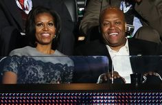 First Lady Michelle Obama sits with brother Craig Robinson during day two of the Democratic National Convention at Time Warner Cable Arena in Charlotte, North Carolina.