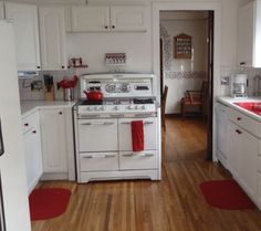 All white kitchen with red accents