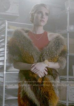 Chanel's red asymmetric dress and fur stole on Scream Queens.  Outfit Details: http://wornontv.net/54349/ #ScreamQueens