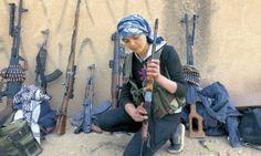 Las mujeres kurdas que expulsaron al Estado Islámico de Kobani en la frontera turca. Un 40% de ellas forma parte de las YPG Unidades de Protección del Pueblo.