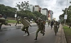 Riot police charge towards opposition supporters during a protest demanding the disbandment of the electoral authority for corruption in Nairobi, Kenya