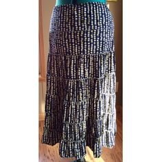 "Just In: Max Studio Maxi Skirt Beautiful navy blue and white and yellow tiered appearing mid length skirt from Max Studio.  Navy blue with white pattern and ""ruffles"" Condition: EUC - no signs of wear, no rips stains odors - LIKE NEW Material: Poly/spandex blend Size Medium Waist: 28"" unstretched (LOTS OF STRETCH AVAILABLE though) Length: 28"" Max Studio Skirts Maxi"