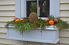 Instead of putting the window boxes away for the winter, I used fresh greens and pinecones from the yard to cover the board. Finishing nails held the pineapple, apples and oranges in place making it to replace the fruit if necessary. Christmas Window Boxes, Winter Window Boxes, Christmas Porch, Winter Christmas, Christmas Decorations, Christmas Ideas, Xmas, Porch Boxes, Yellow Twig Dogwood