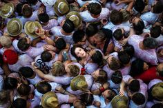 Revellers enjoy the atmosphere during the opening day or 'Chupinazo' of the San Fermin Running of the Bulls fiesta on July 2015 in Pamplona, Spain. The annual Fiesta de San Fermin, made famous by. Get premium, high resolution news photos at Getty Images Renaissance Kunst, Renaissance Paintings, National Geographic, San Fermin Pamplona, David Ramos, Running Of The Bulls, Foto Top, The Sun Also Rises, Powerful Pictures