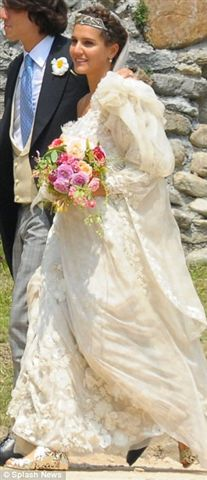 The bride's gown was made from flower-embellished Missoni silk with voluminous organza sleeves.
