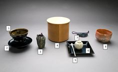 1. tenmoku chawan, 2. lacquer dai, 3. chaire in shifuku, 4. mage wappa mizusashi, 5. formal ivory chashaku, 6. yohoubon (tray) for chaire, 7. apple shape chaire & shifuku, 8. raku chawan