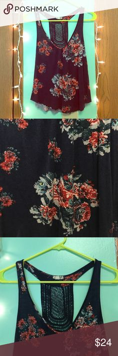 🌹 Floral print tank top 🌹 Only worn once! Super gorgeous floral print tank top! It has a cute racerback as well. 💖 Base color is navy & it has pretty red colored flowers. Very soft material! Eyeshadow Tops Tank Tops
